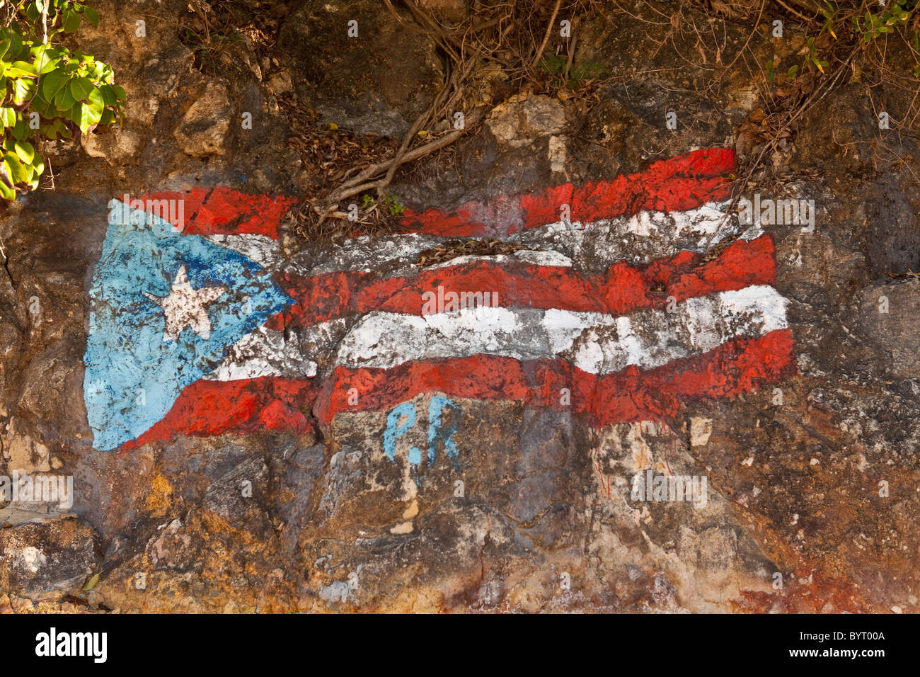 Flag of puerto rico stock photos flag of puerto rico stock puerto rican flag painted on the rocks crash boat beach aguadilla puerto rico stock image biocorpaavc Image collections