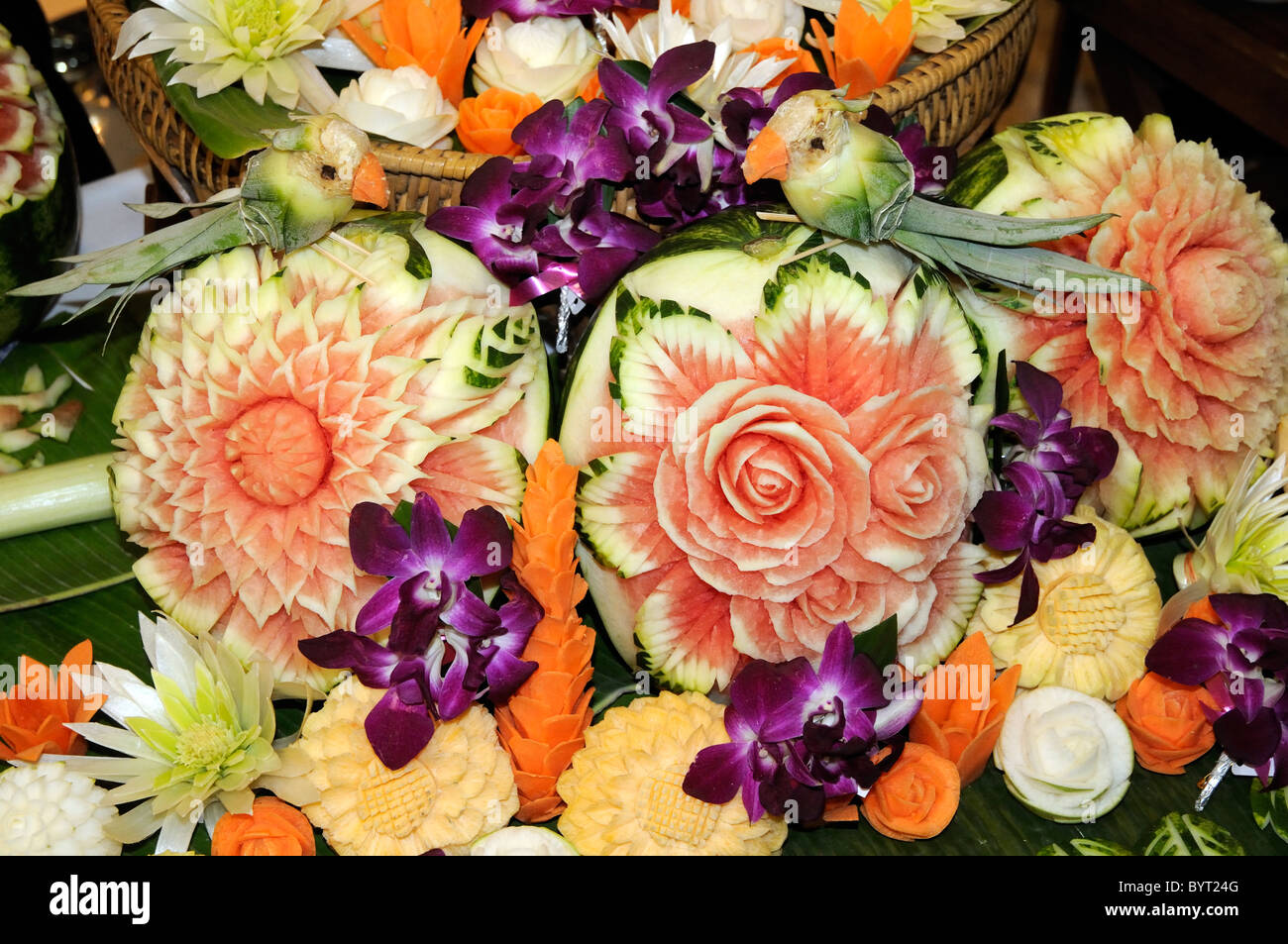 Flower Arrangement Carved From Fresh Fruit And Vegetables Including A Bird Made Pineapple