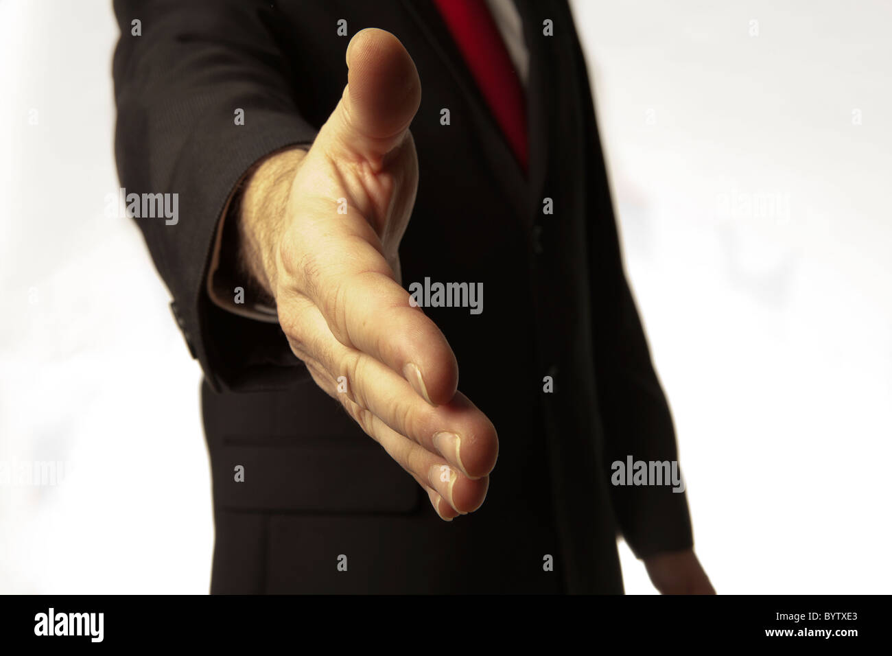 Stock Photo  Man In Business Suit And Red Tie About To Shake Your Hand