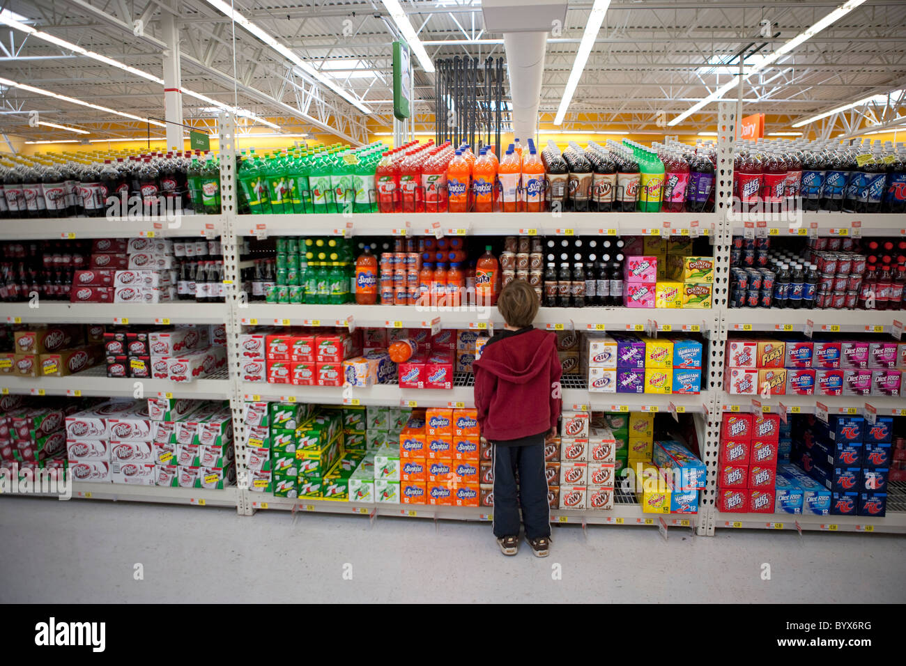 Seven Year Old Boy Stands In Front Of A Giant Aisle Of