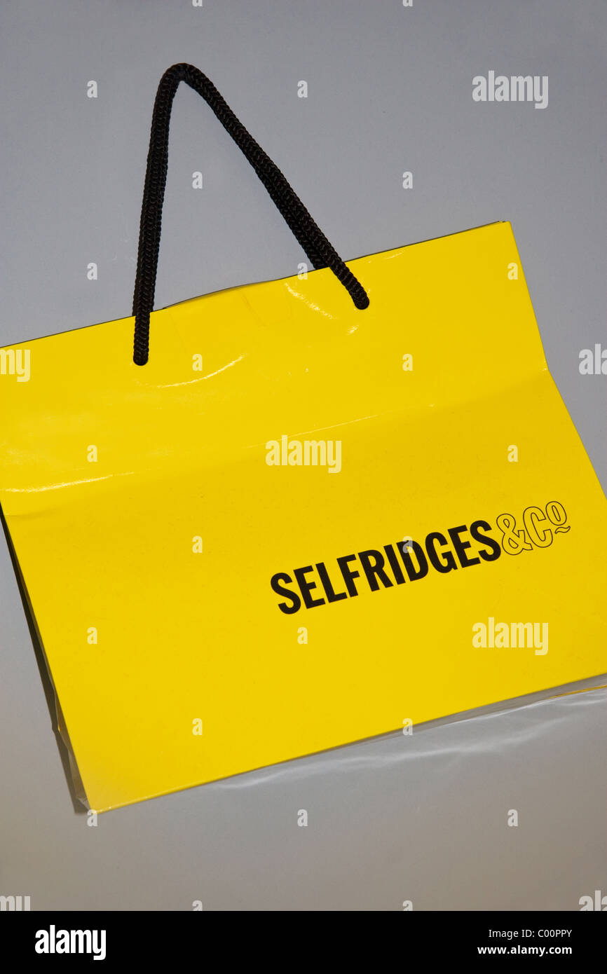 Selfridges yellow carrier bag Stock Photo, Royalty Free Image ...