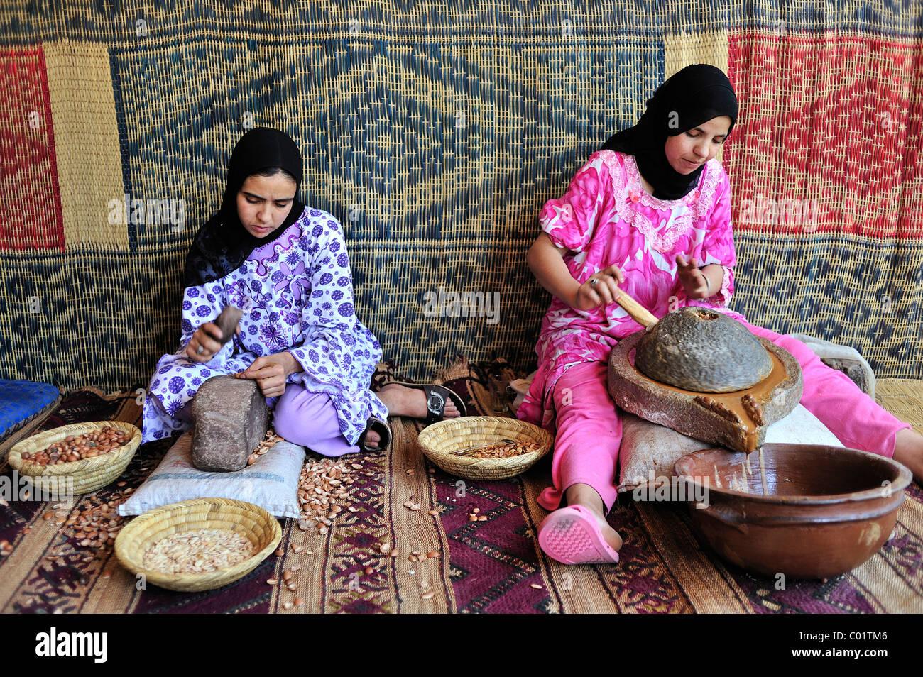 two-berber-women-producing-argan-oil-mor