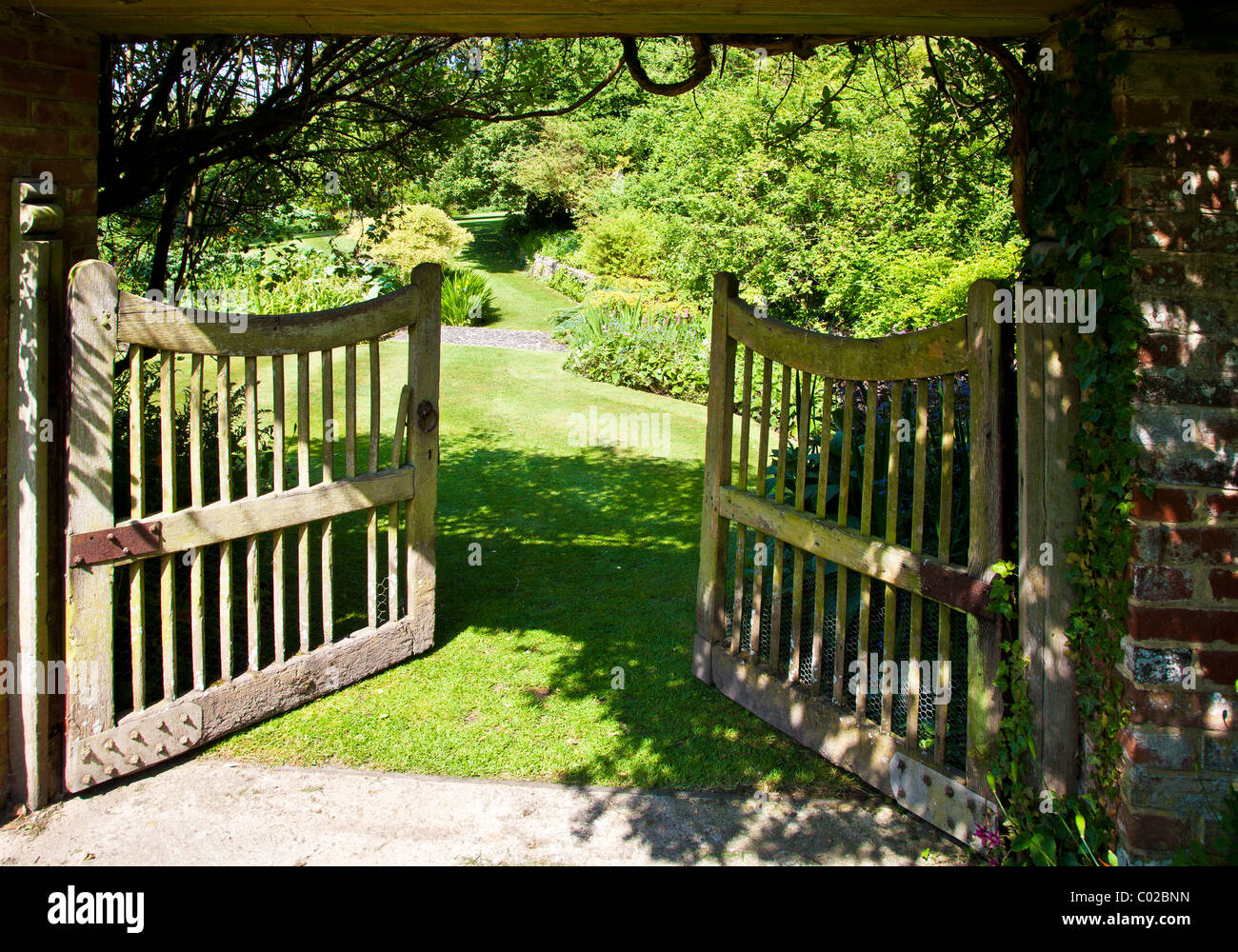 Superb An Open Wooden Garden Gate In An English Country Garden Showing A View To  The Wider Garden Beyond.