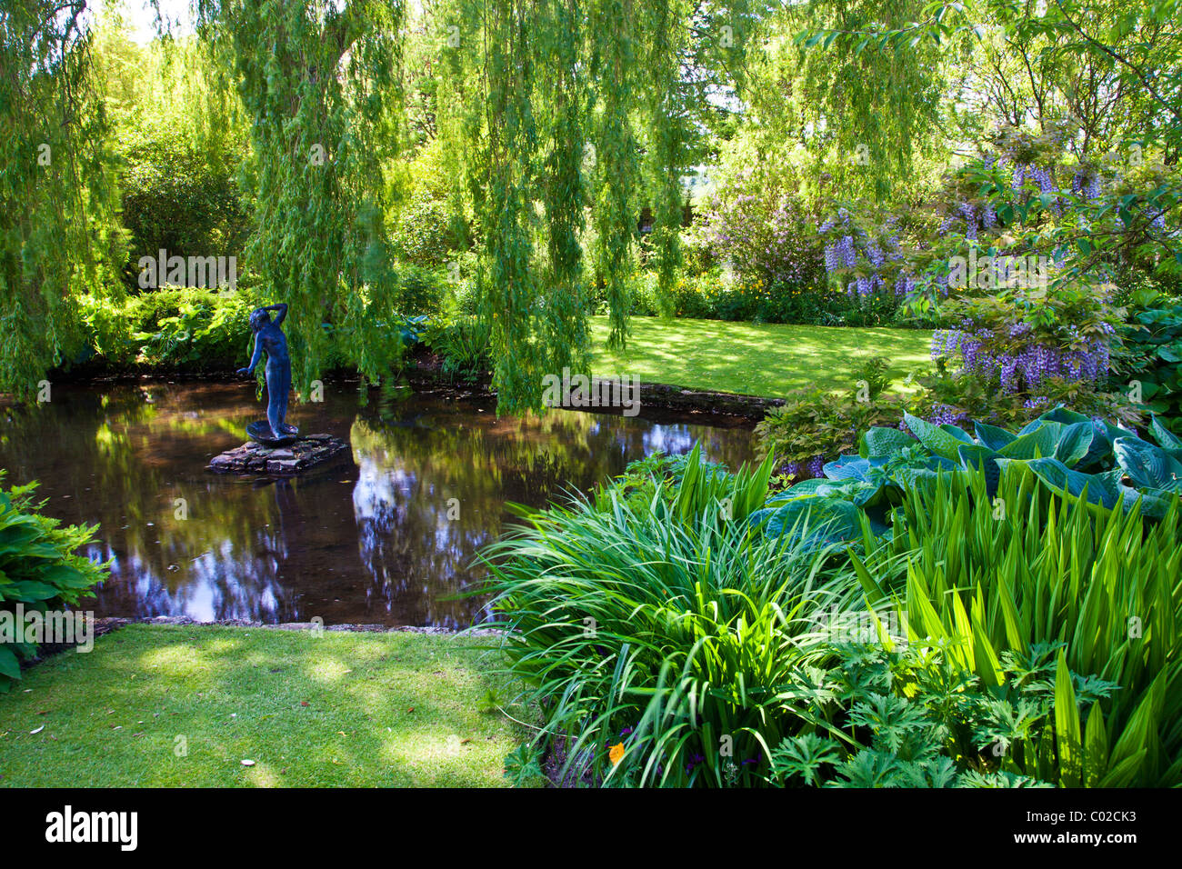 An ornamental garden pond in an english country garden for Garden with pond