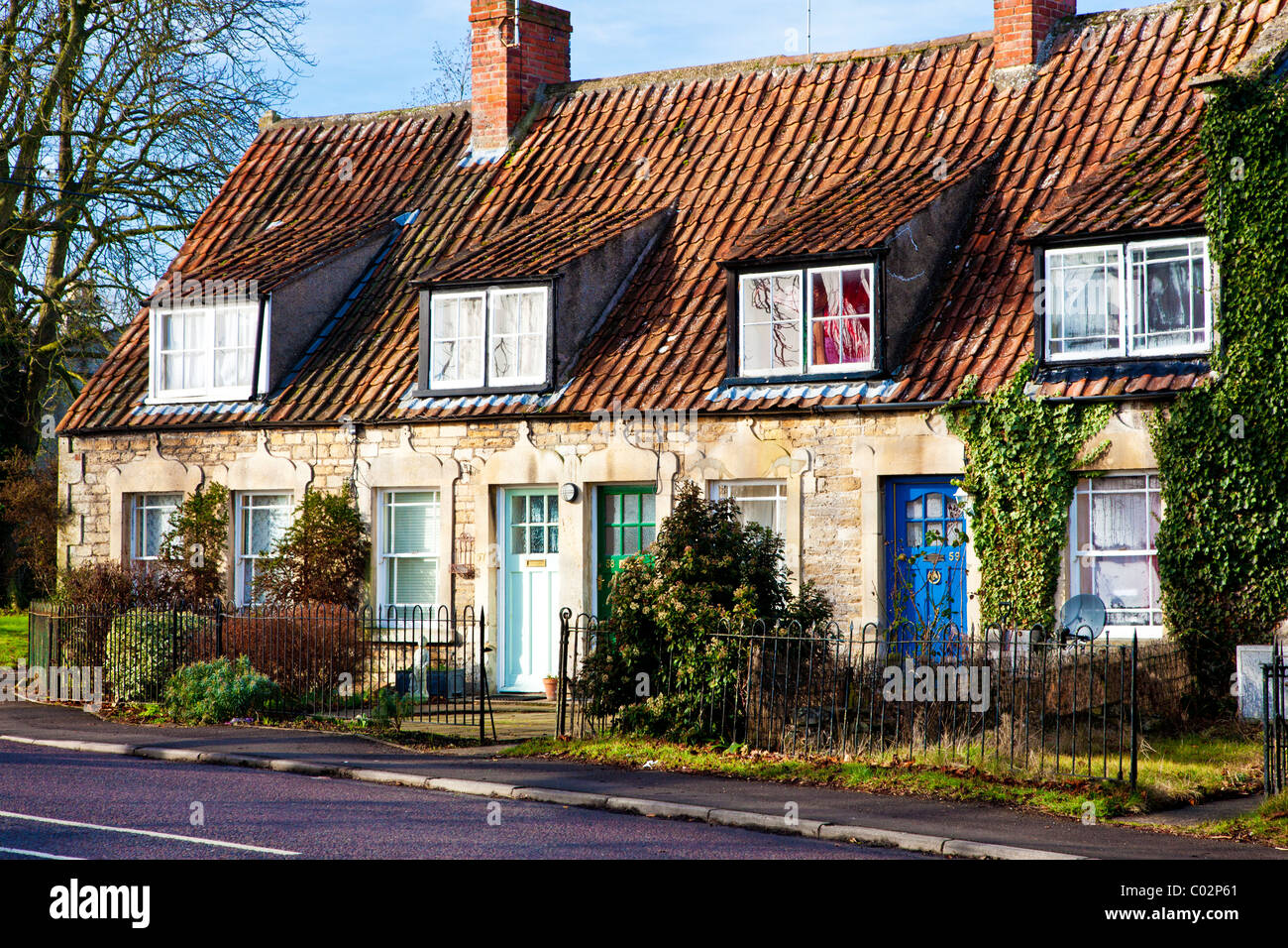 A Row Of Terraced Stone Cottages With Dormer Windows And