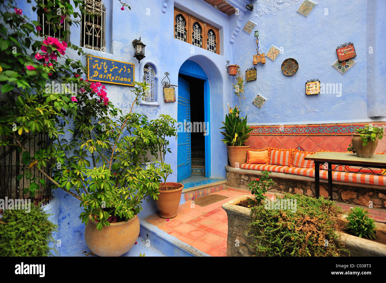 Front door of a house with a sitting area and plants chefchaouen front door of a house with a sitting area and plants chefchaouen reef mountains morocco africa rubansaba