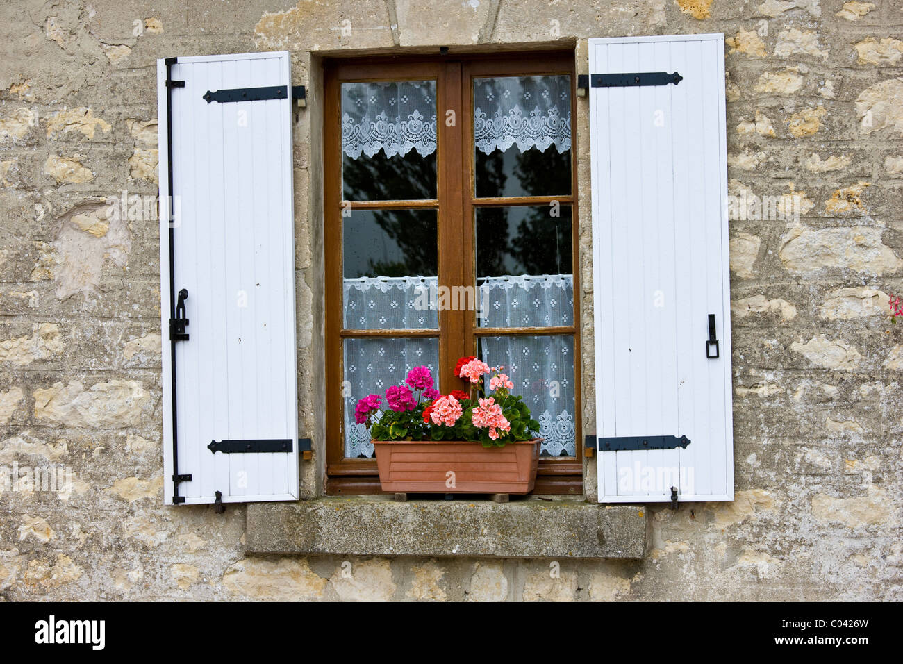 Typical French Window With Lace Curtain And Pelmet Box Wooden Shutters Normandy France