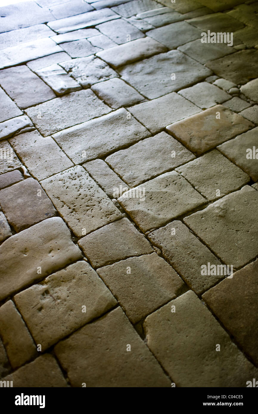 old stone floor in the ancient church at st amand de coly in the stock photo royalty free image. Black Bedroom Furniture Sets. Home Design Ideas