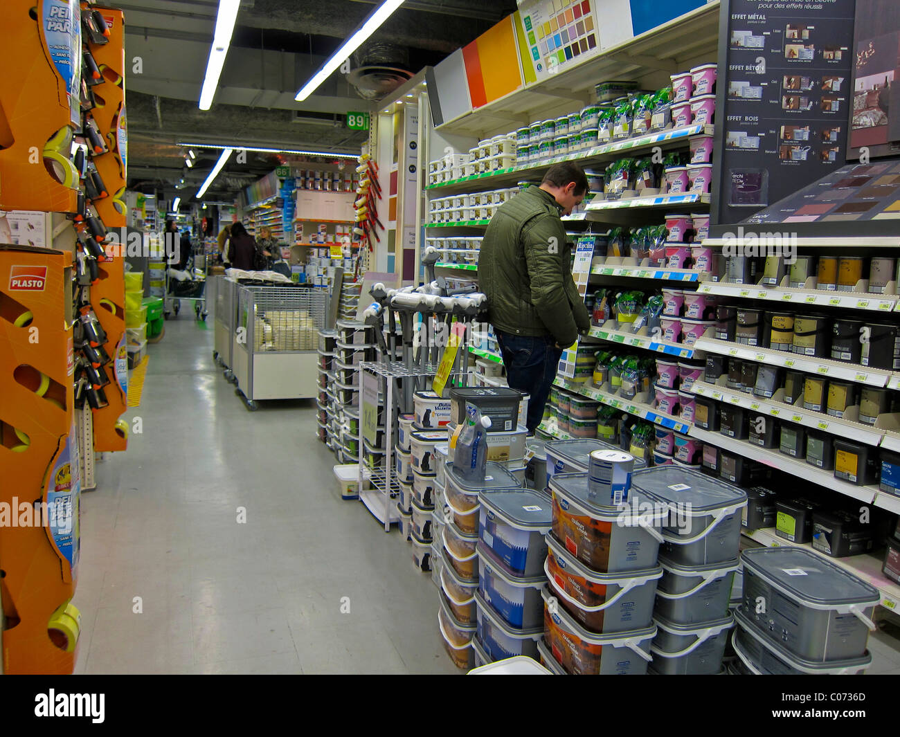 Paris france french hardware store shops man shopping for Le roy merlin paris