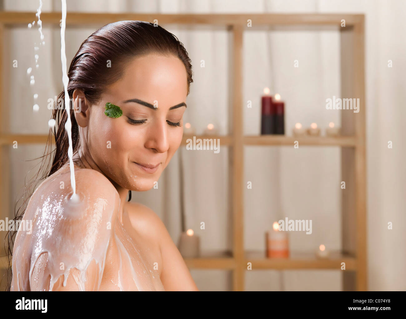 Woman taking a milk bath in a health spa Stock Photo, Royalty Free ...