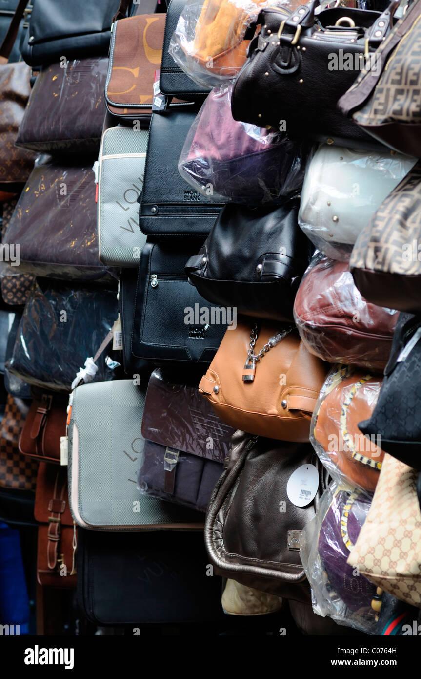 Fake designer leather bags handbags pirate pirated luxury goods on sale stall petaling street chinatown kuala