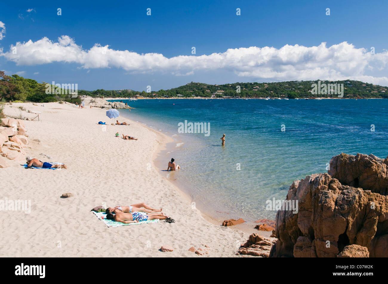 Tourists on the sandy beach cala rossa east coast golfe for Calla rossa