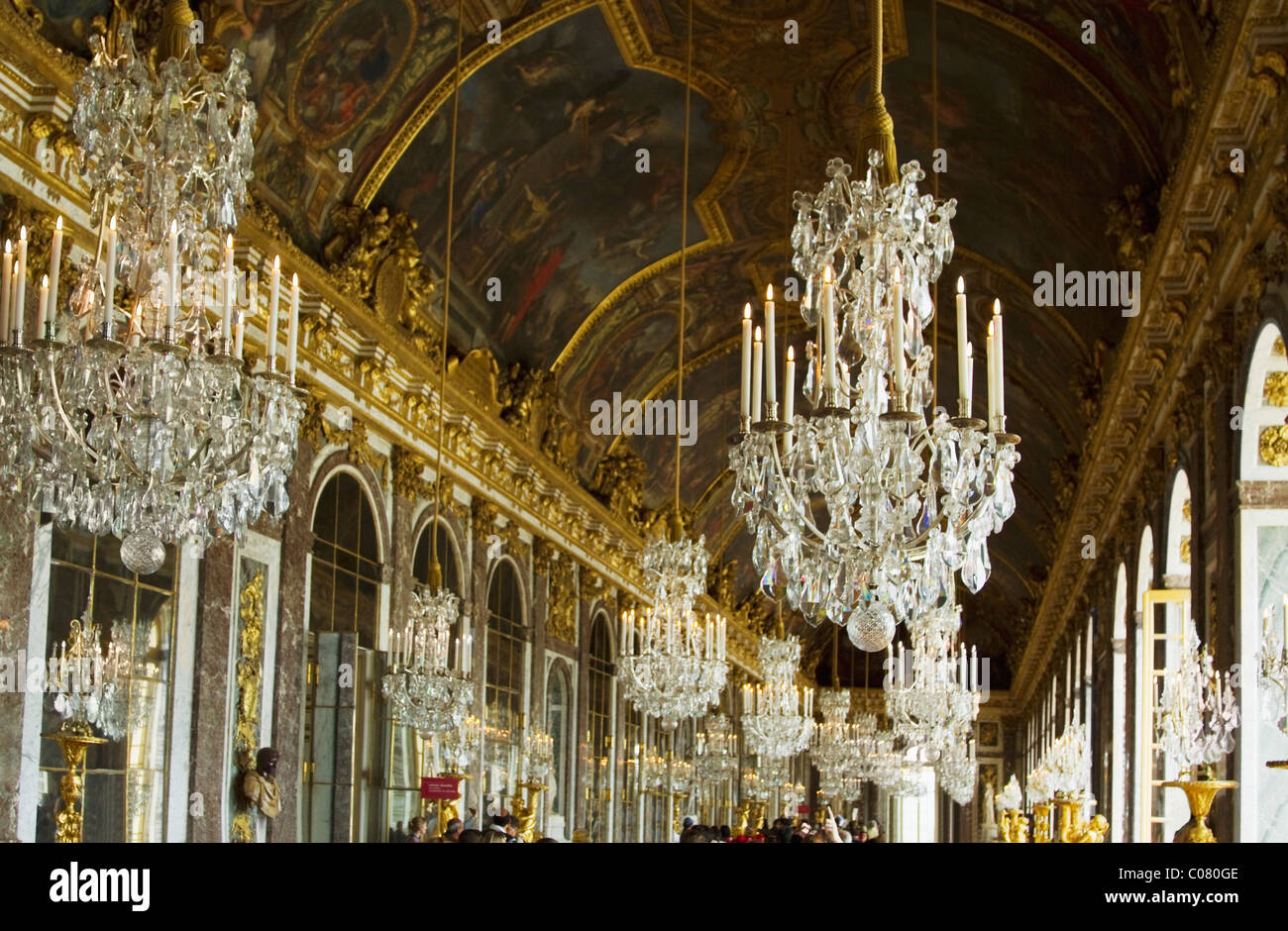 Chandeliers hanging in the corridor of a palace hall of mirrors chandeliers hanging in the corridor of a palace hall of mirrors chateau de versailles versailles paris france sciox Images