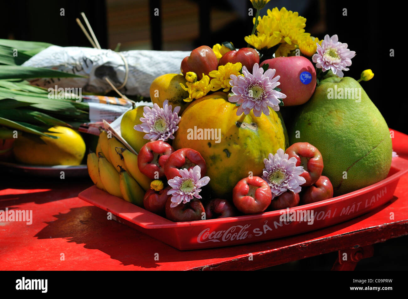 Sacrificial offering fruit and flowers at the largest and most Stock