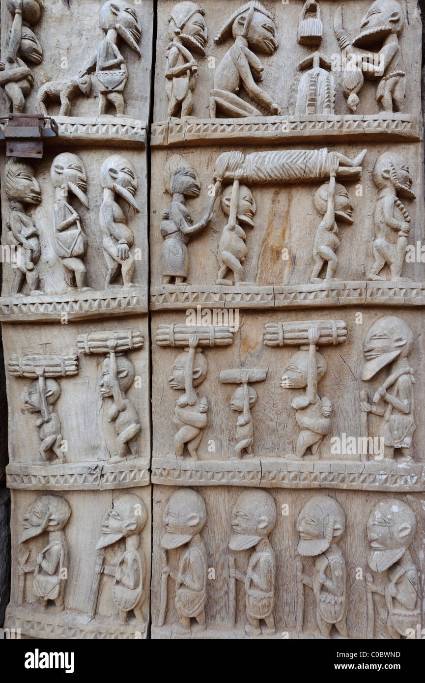 Detail of a beautifully carved Dogon door depicting daily life situations. Pays Dogon Youga Piri. Mali & Detail of a beautifully carved Dogon door depicting daily life ...