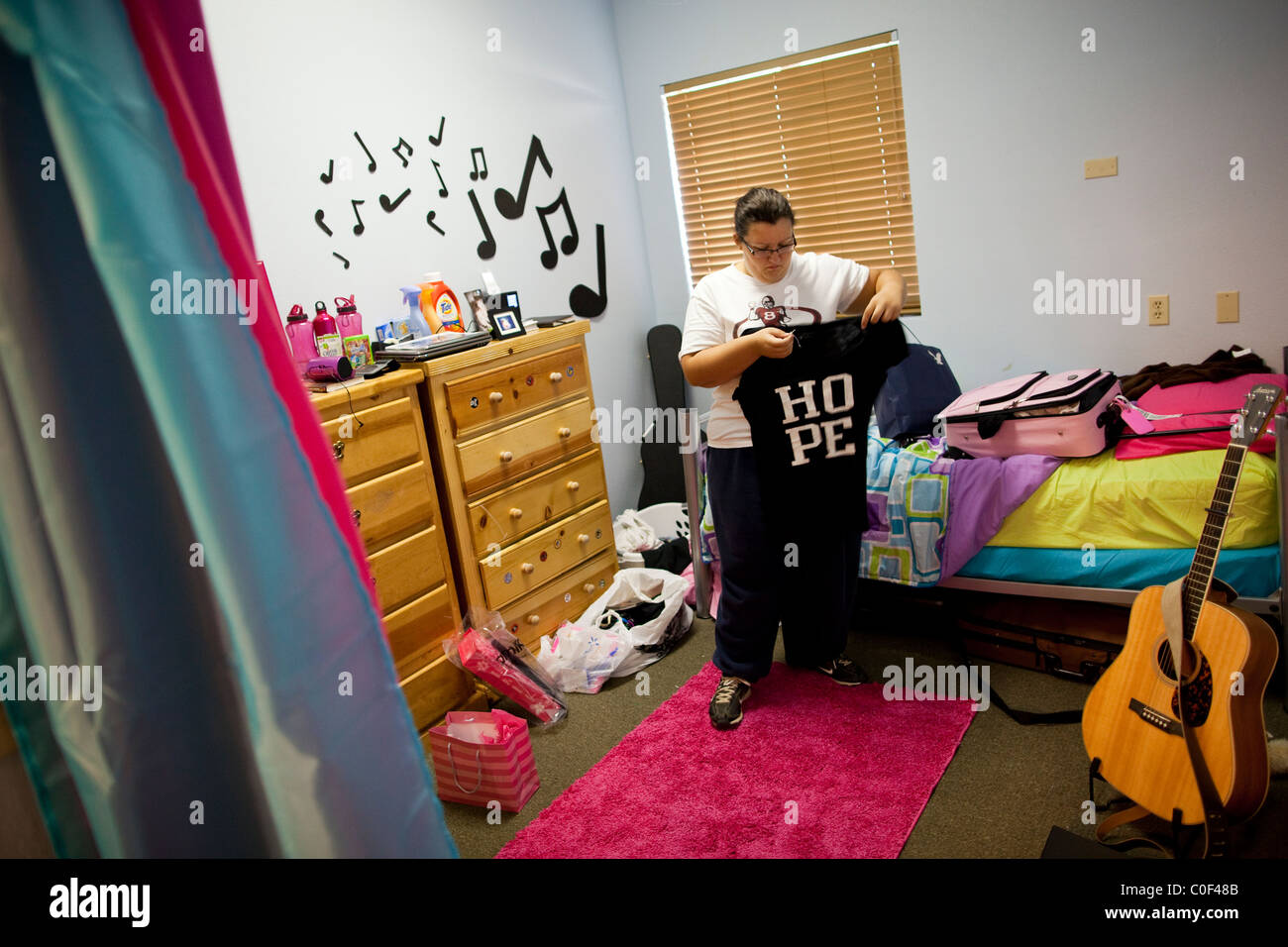 Reedley, California, United States. A Teenage Girl Folds Her Laundry In Her  Dorm Room At Wellspring Academy, A Boarding School Part 94