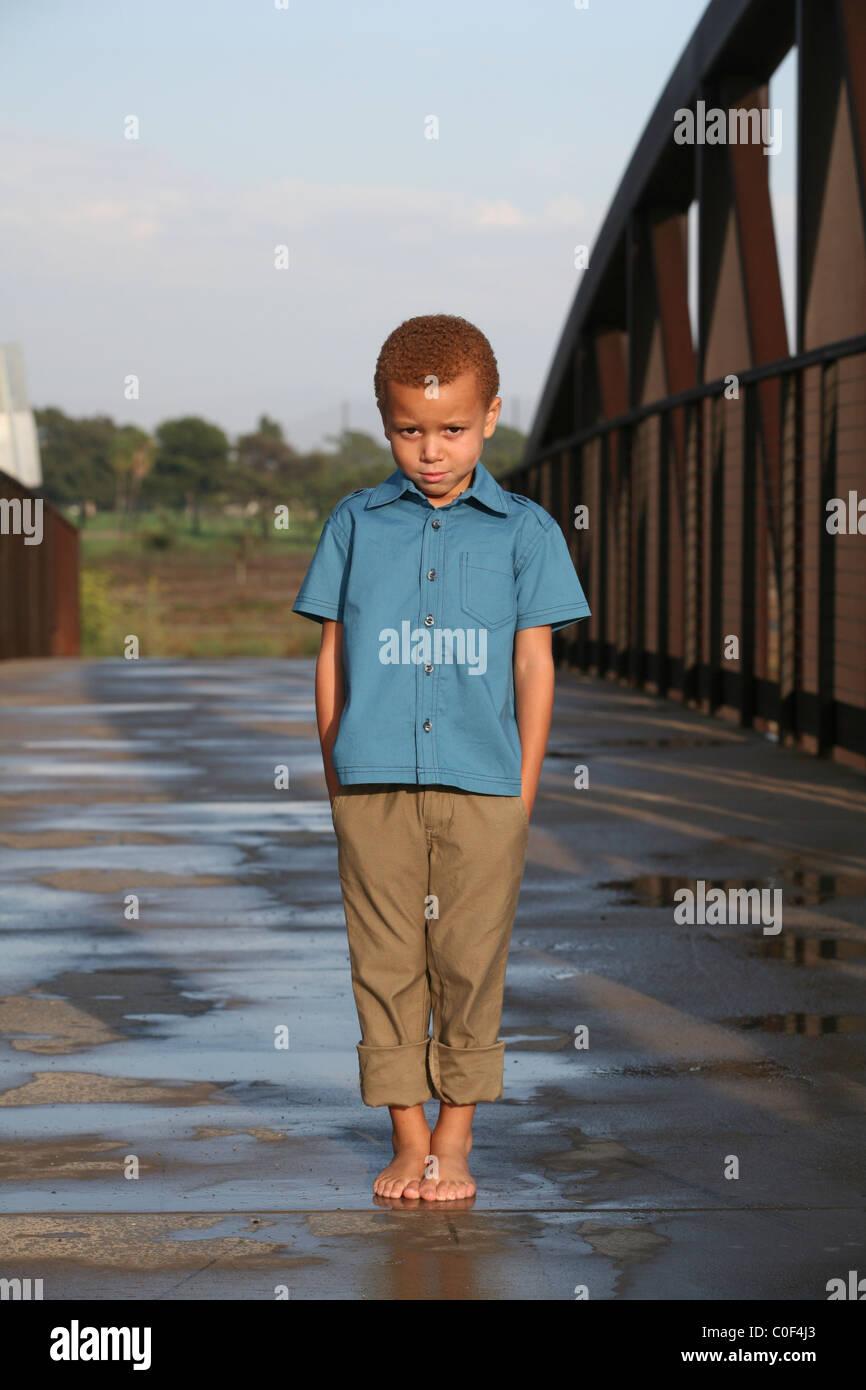 young boy standing on bridge stock photo royalty free