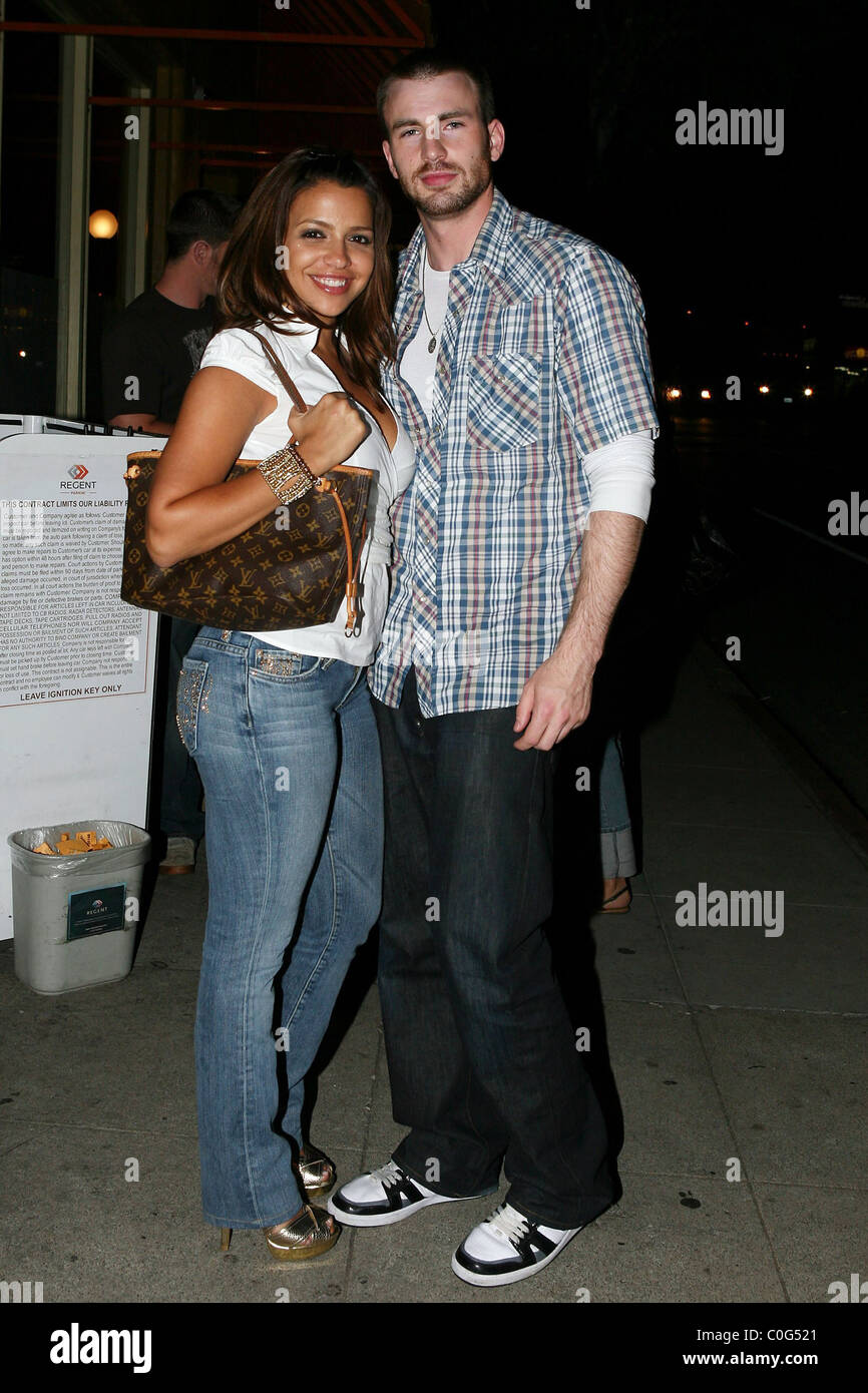 chris evans and his girlfriend outside a restaurant in la