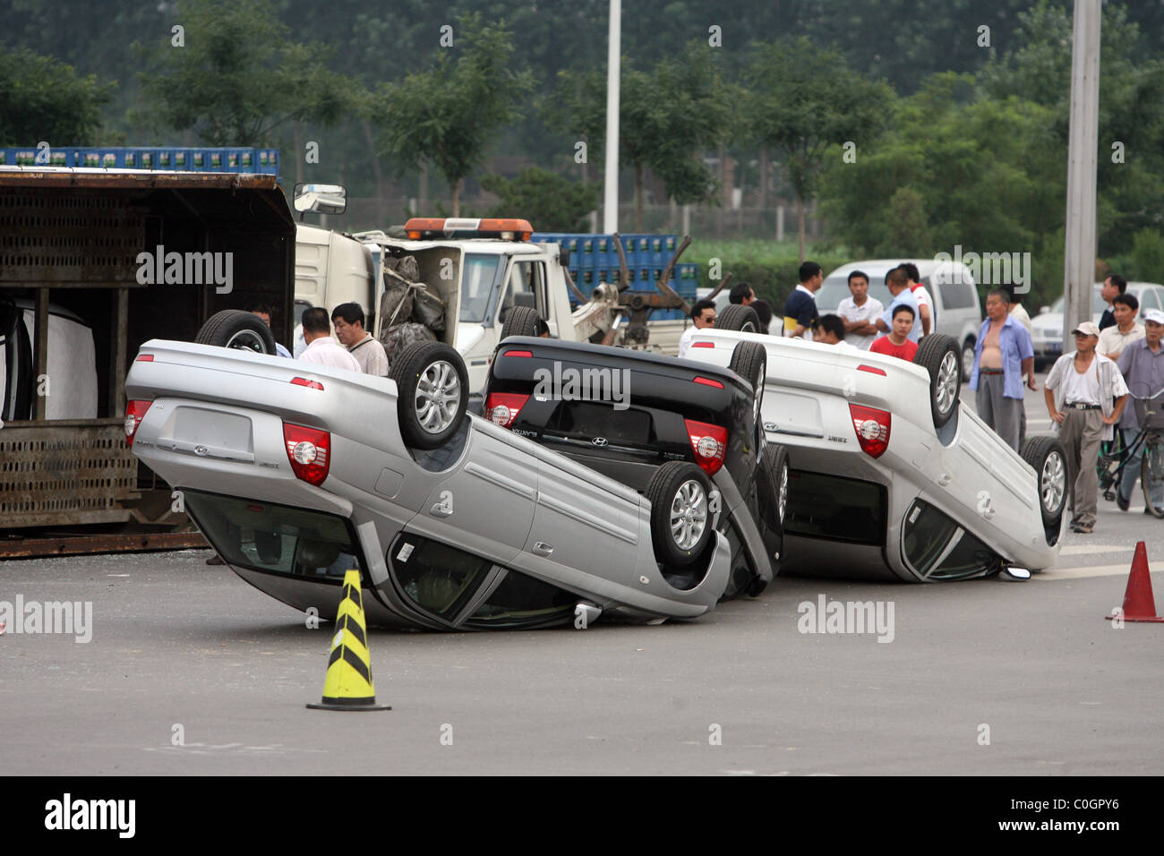 Car carrier flips on junction a haulage truck carrying a fleet of brand new cars flipped