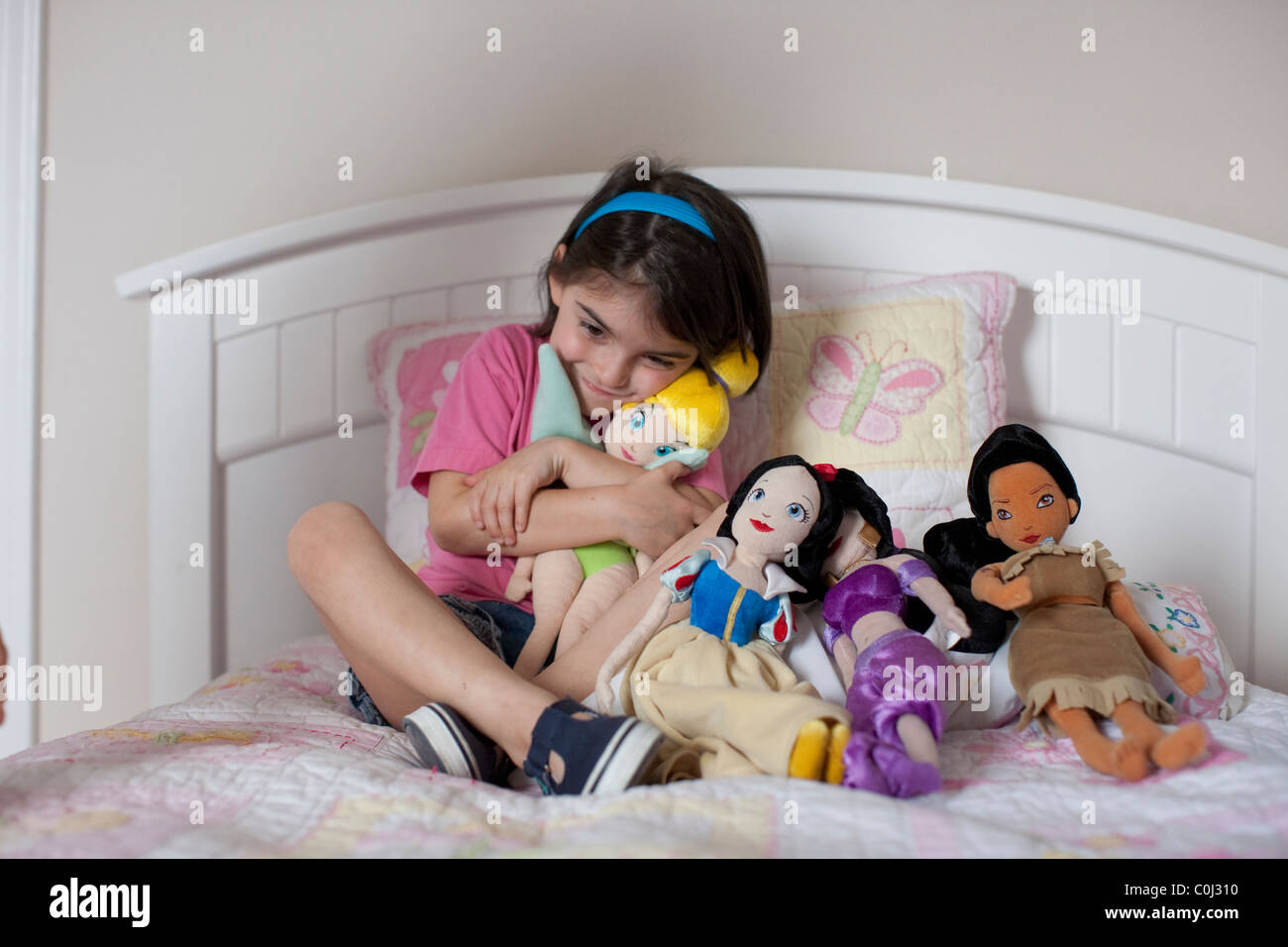 Year old mexican american girl plays with her disney character stock