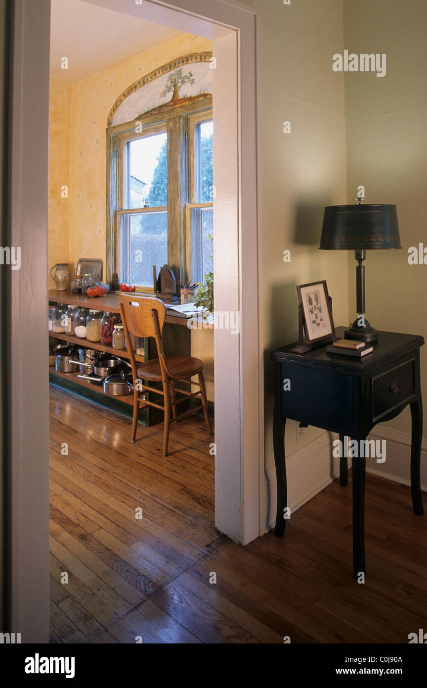 INTERIOR VIEW OF 1920S BUNGALOW STYLE HOME WITH PAINTED WOODWORK AND NATURAL WOOD FLOORS