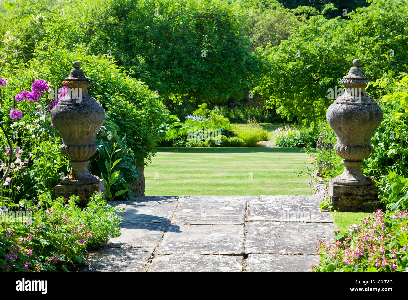 View From Paved Garden Terrace With Stone Finials Onto The Lawn
