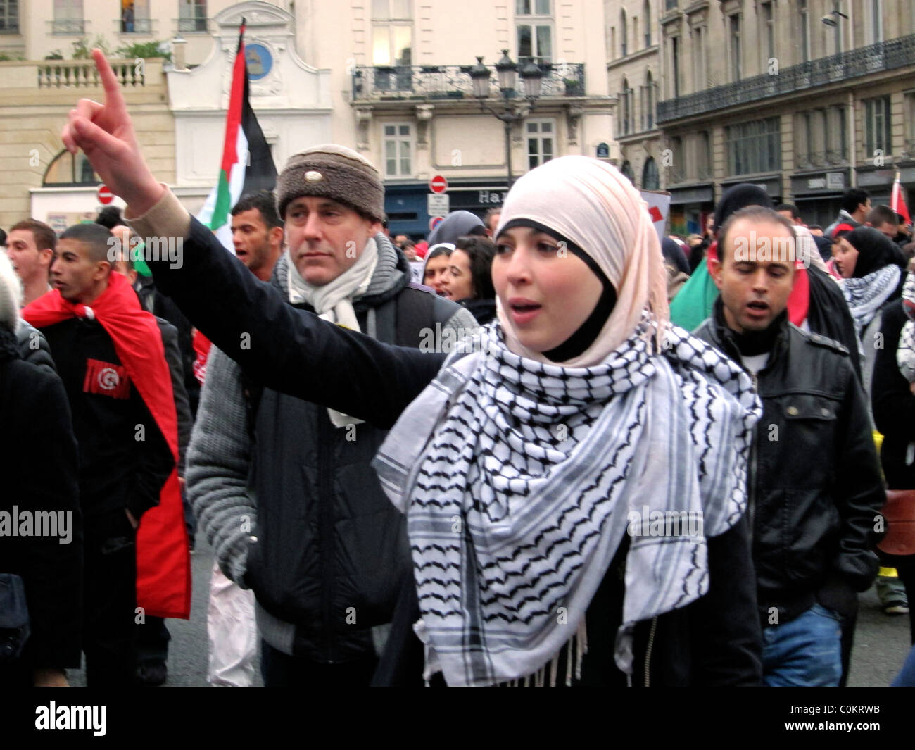Paris france libya demonstration in support of libyan france libya demonstration in support of libyan revolution veiled women in head scarf marching and chanting slogans in street arab spring protests sciox Choice Image