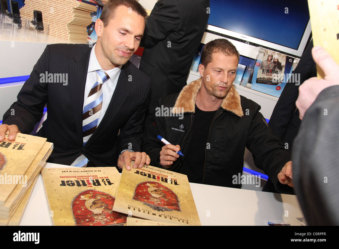 til schweiger signing autographs grand opening o2 flagship store at stock photo royalty free. Black Bedroom Furniture Sets. Home Design Ideas