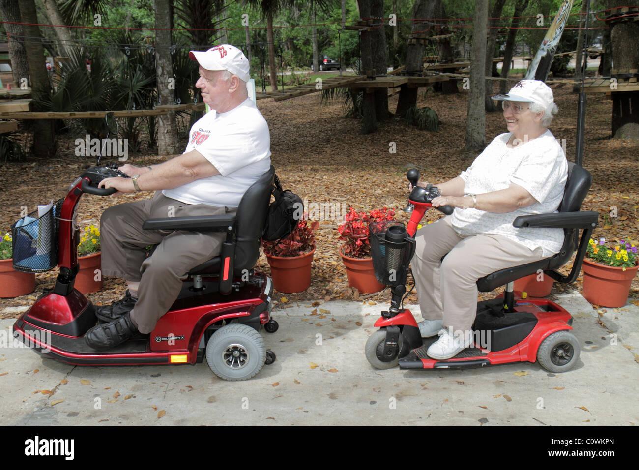 Orlando Florida Sanford Central Florida Zoo U0026 And Botanical Gardens Senior  Man Woman Disabled Electric Cart Scooter