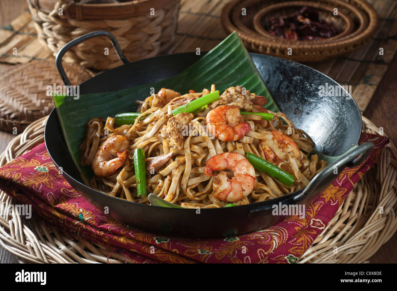 Char kway teow stir fried noodles on banana leaf south for Aja east asia cuisine