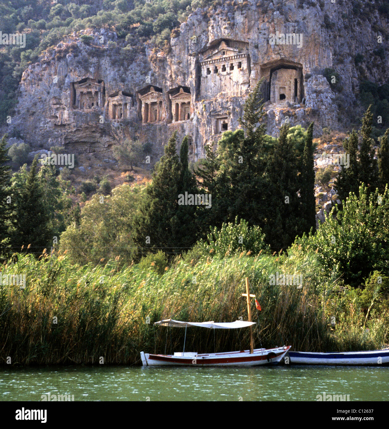 The Lycian rock tombs in the cliffs above the ruins of ...