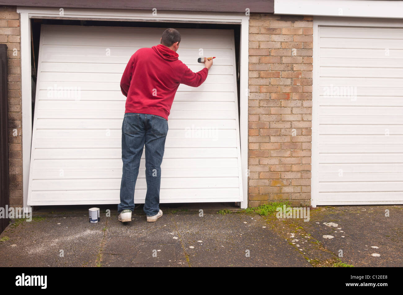 Decorating garage man door images : A MODEL RELEASED man doing DIY painting a garage door in the Uk ...