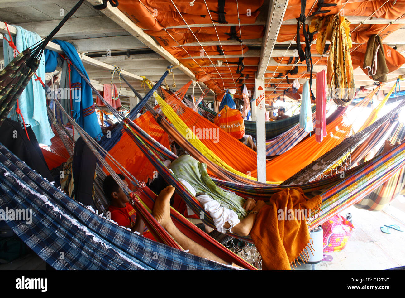 man sleeping on a hammock   traveling through the amazon river on a crowded boat   amazon ferry boat stock photos  u0026 amazon ferry boat stock images      rh   alamy