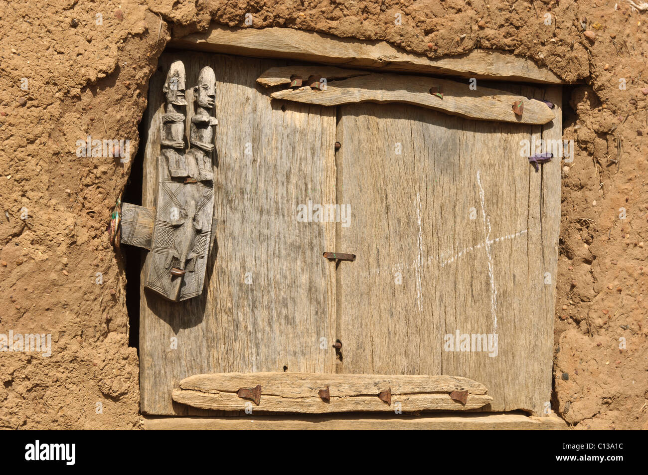 Granary door with carved Dogon wooden door lock. Begnemato village on Gondo plain. Dogon & Dogon Mali Granary Door Carved Stock Photos \u0026 Dogon Mali Granary ...
