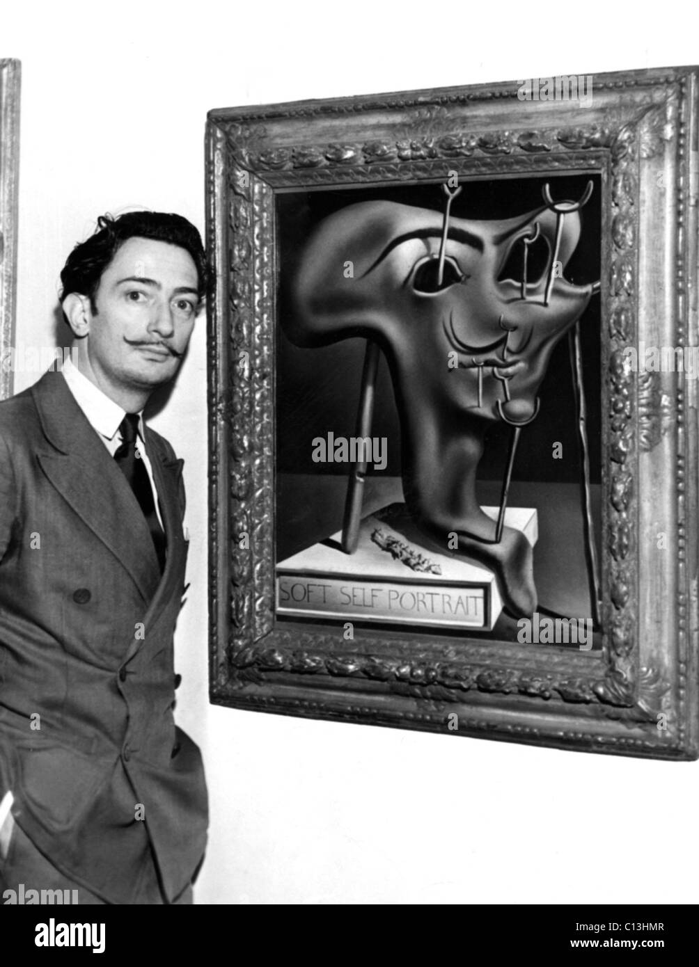 Salvador Dali, showing off his piece entitled 'Soft Self Portrait ...