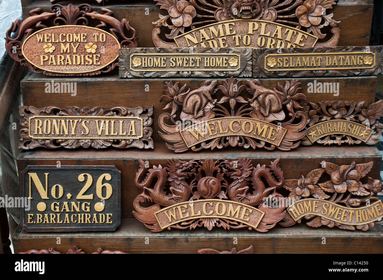 Elaborately carved wooden signs made to order in Bali ...