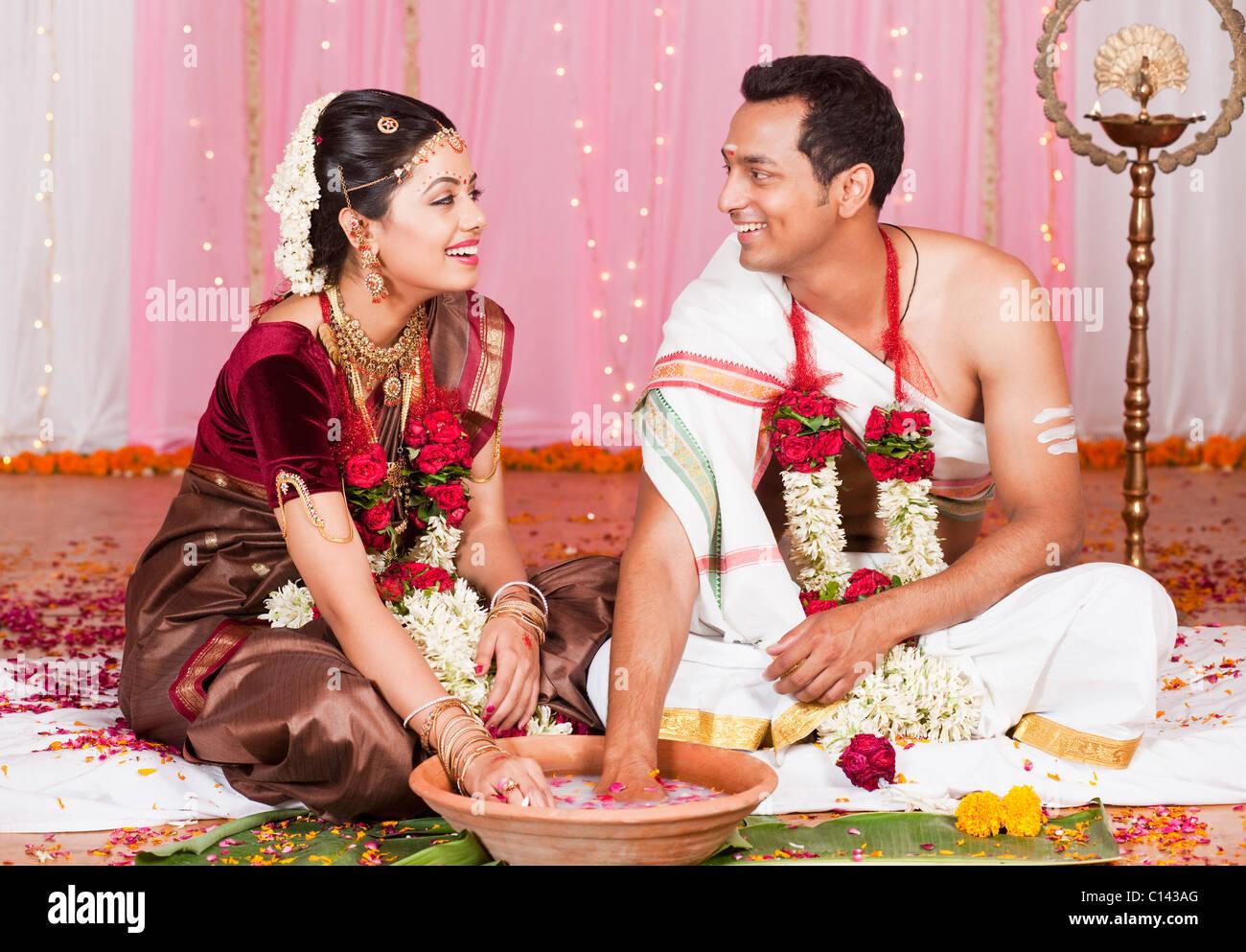 Newlywed Couple Playing Kangana Jua During South Indian Wedding Ceremony