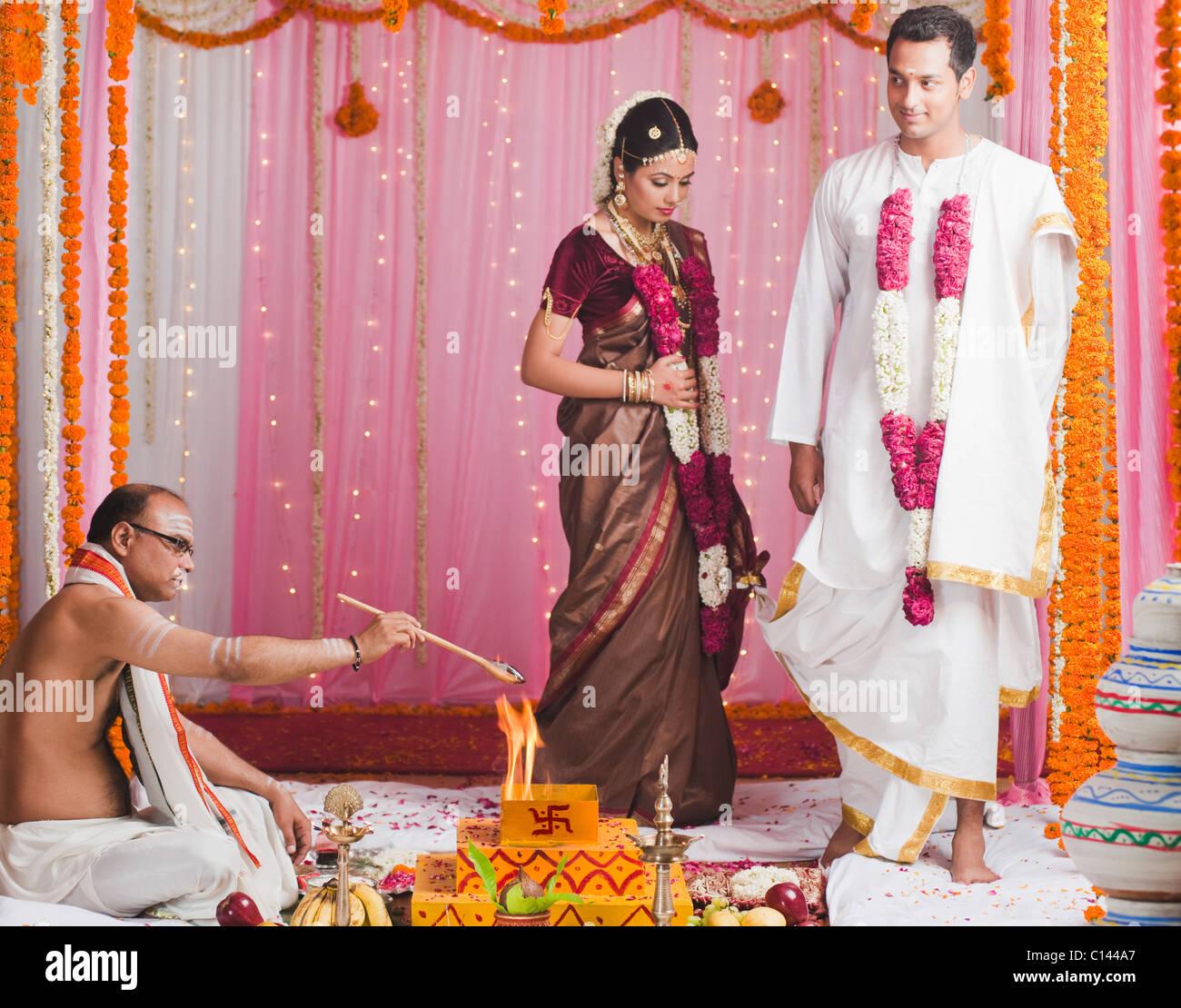 Bride And Bridegroom Taking Saptha Padhi During South Indian Wedding
