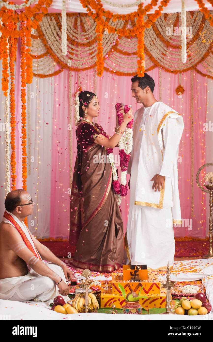 Bride Putting Garland To A Bridegroom During The South Indian Wedding Ceremony