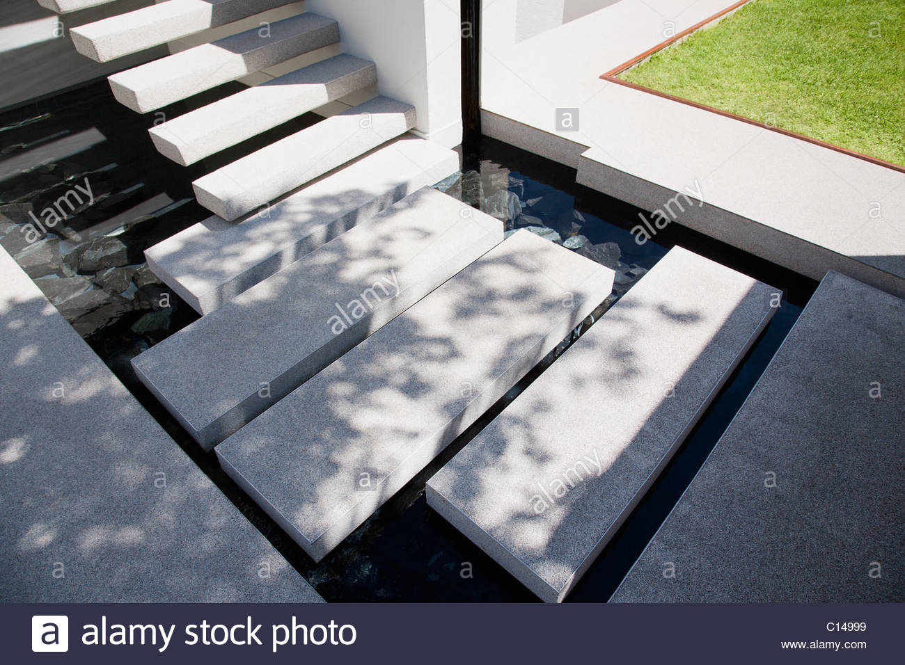 floating stairs over outdoor pond in backyard stock photo royalty