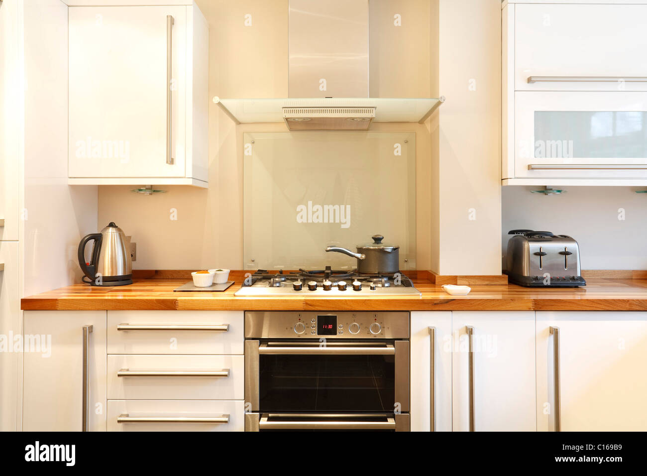 modern kitchen with a gas hob chimney hood wooden