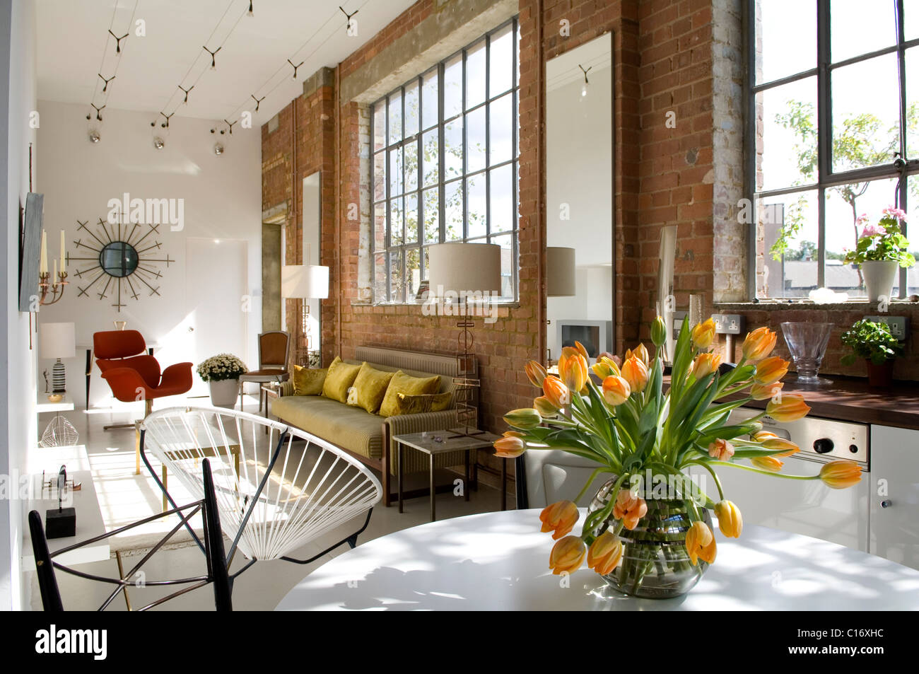 Acapulco chair living room - Open Plan Kitchen Living Space In Converted Warehouse With Crittal Windows Acapulco Chair And Sunburst Mirror
