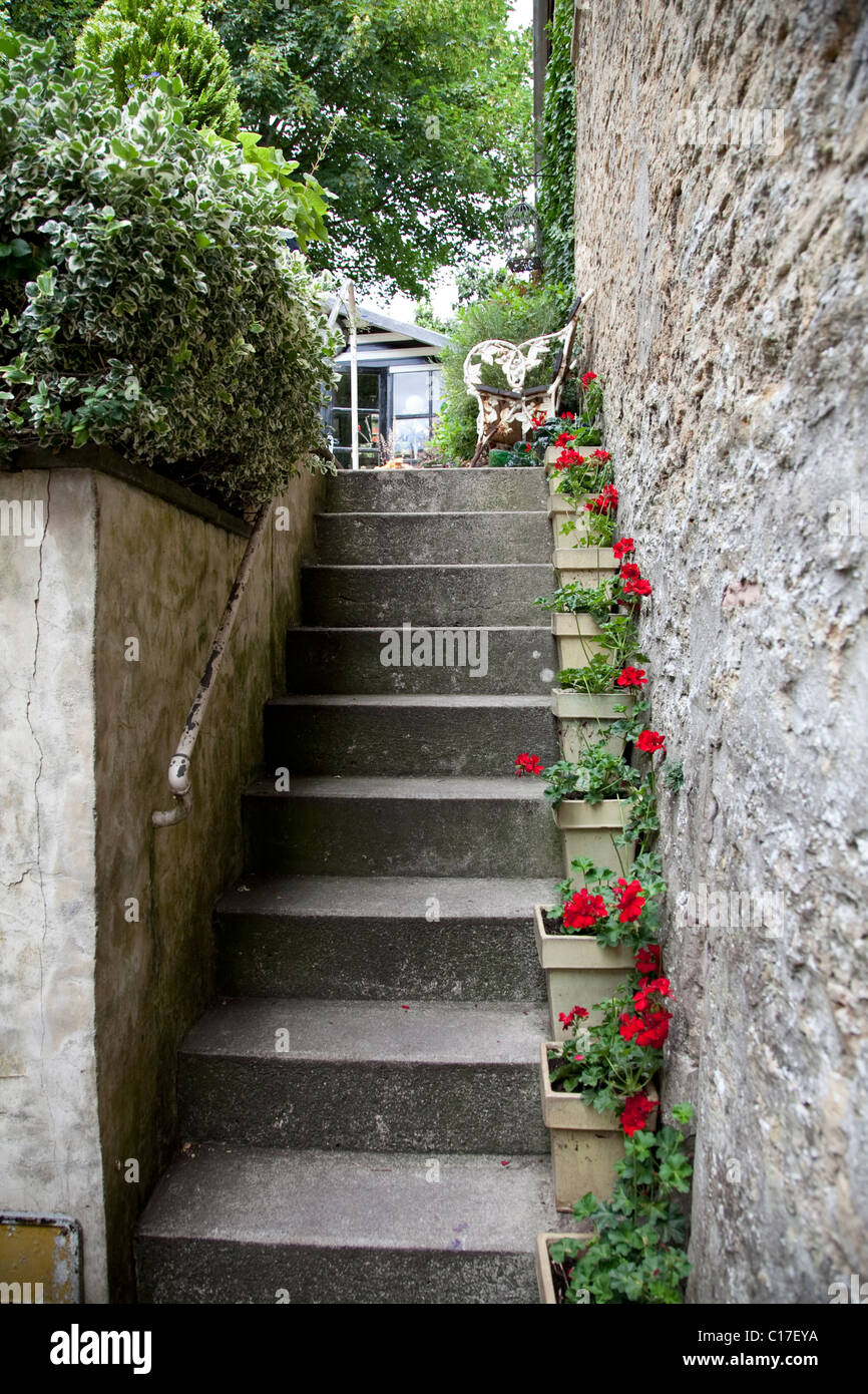 Stock Photo   Stone Steps Leading Up To A Garden With Planters Placed On  The Steps