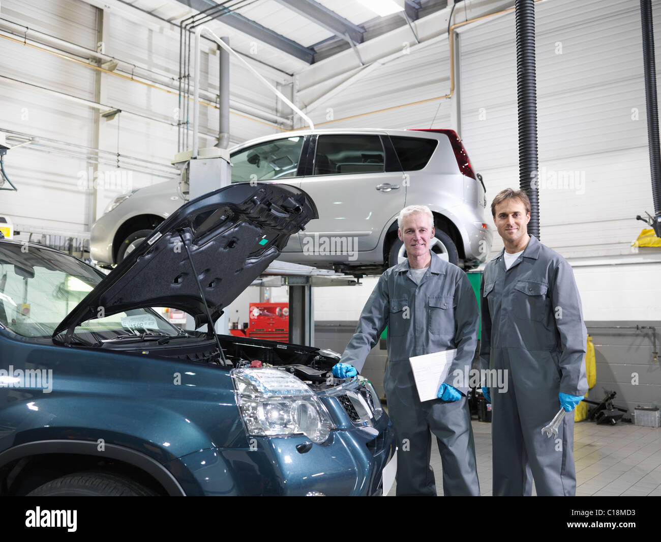 mechanics working in car dealership stock photo royalty free image 35227055 alamy. Black Bedroom Furniture Sets. Home Design Ideas