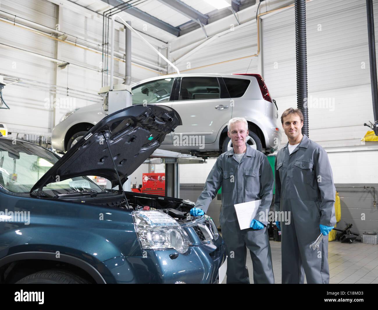 mechanics working in car dealership stock photo royalty free image 35227055 alamy. Black Bedroom Furniture Sets. Home Design Ideas