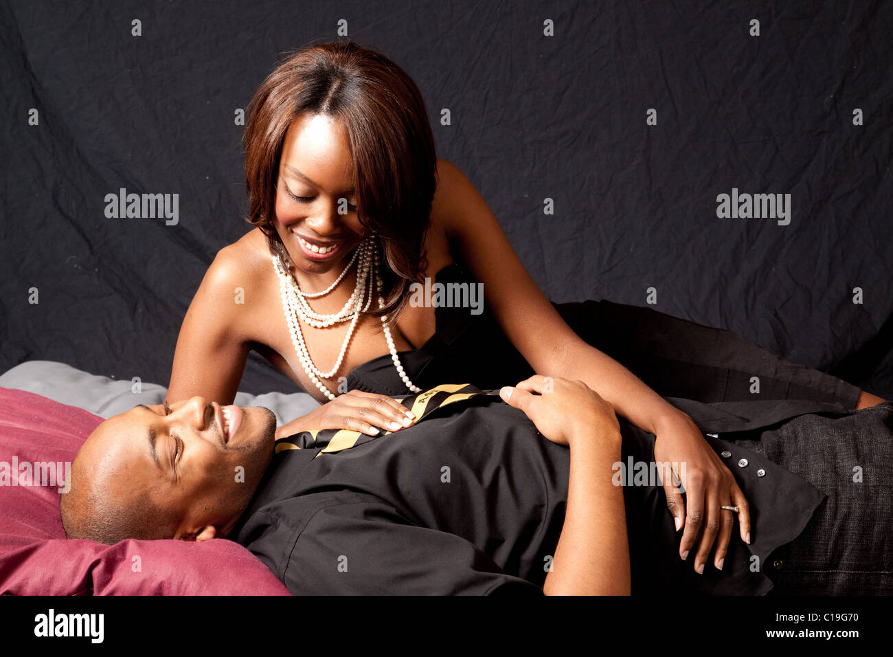African American couple in a romantic reclining position smiling with joy  sc 1 st  Alamy & African American couple in a romantic reclining position ... islam-shia.org