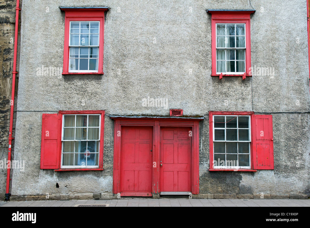 Red Painted Front Door And Windows On Terraced Houses In Oxford, UK