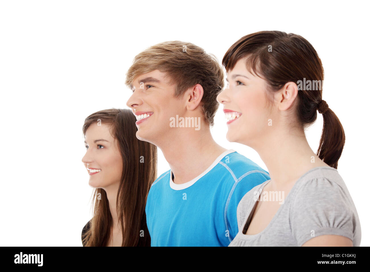 Three Young Happy Friends. Two Girls One Boy Smiling And