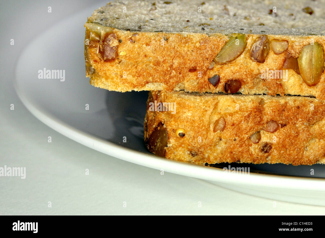 Two Slices Of Wholemeal Bread On A White Plate Stock Photo ...