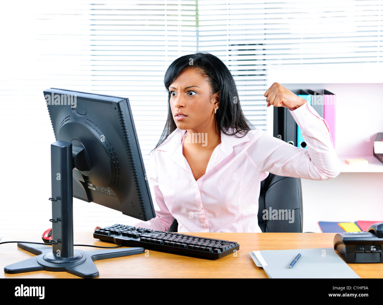 Receptionist angry stock photos receptionist angry stock images angry young black business woman punching computer in office stock image sciox Images